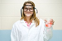 Female student holding flask of chemicals