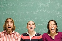 Three students laughing showing surprise