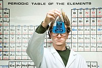 Male student performing an experiment