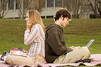 Two student studying outdoors