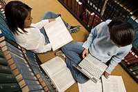 Two female students studying in the library
