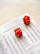 Dice on newspaper (thumbnail)