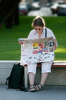 A lost tourist consults her map at Schwarzenberg Platz, in Vienna, Austria