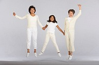 Female family members jumping together