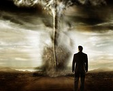 Businessman watching a tornado