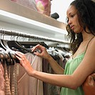 Young woman clothes shopping
