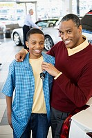 Father and son at a car dealership