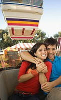 Couple riding a Ferris wheel together