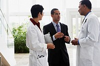 Doctors talking to businessman