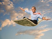 Businessman flying on a dollar bill