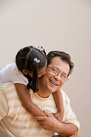 Young girl kissing father´s cheek