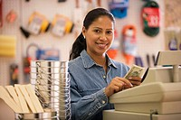 Female cashier using cash register