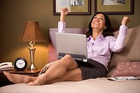 Businesswoman celebrating in her hotel room