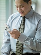 Young businessman using his cell phone