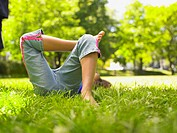 Lower section of girl laying in grass