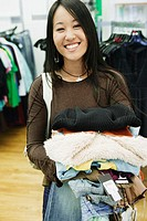 Young woman smiling for the camera while shopping