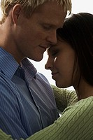 Side profile of a young couple embracing each other (thumbnail)