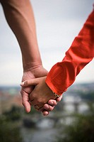 Close-up of a couple holding hands (thumbnail)