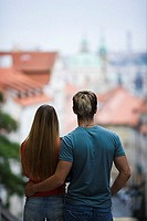 Rear view of a young man standing with a young woman (thumbnail)
