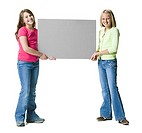 Two young girls holding a blank sign (thumbnail)