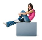 Profile of a teenage girl relaxing on a blank sign and smiling (thumbnail)