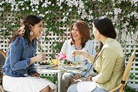 Women eating and talking