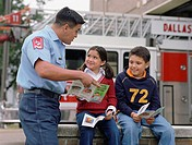 Fireman talking to young children about fire safety