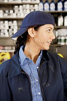 Young female mechanic with oil on her face