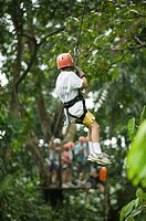 Person in helmet going down on rope