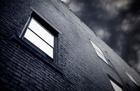 Brick building with brooding sky and window