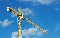 Tower crane against blue sky, Spain, low angle view