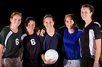 Five young female soccer players with arms around each other, portrait