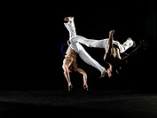 Two young men practicing capoeira