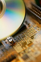 Close-up of a CD and a circuit board
