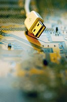 Close-up of a USB cable on a circuit board