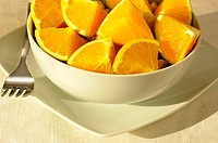 Close-up of slices of orange in a bowl
