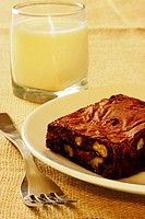 Close-up of a brownie and a glass of milk