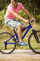 Close-up of a young man riding a bicycle