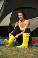 Young woman wearing galoshes