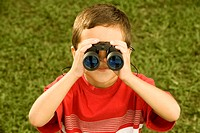 High angle view of a boy looking through a pair of binoculars
