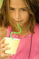 Portrait of a girl drinking from a straw