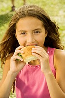 Portrait of a girl eating a burger