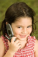 Close-up of a girl talking on a mobile phone