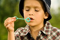 Close-up of a boy holding a bubble wand