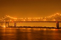 Bridge lit up at night, Mississippi River, New Orleans, Louisiana, USA