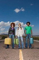 Three Cool Hipsters Holding Suitcases