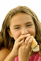 Portrait of a girl eating a hot dog