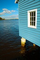 Blue boat house on river, Matilda Bay, Swan River, Perth, Western Australia