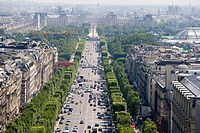 Champs Elysees Avenue, Concorde Obelisk and Louvre Museum in background. Paris. France