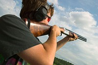 Skeet shooting, aiming the 12 gauge, over-under double barrell shotgun